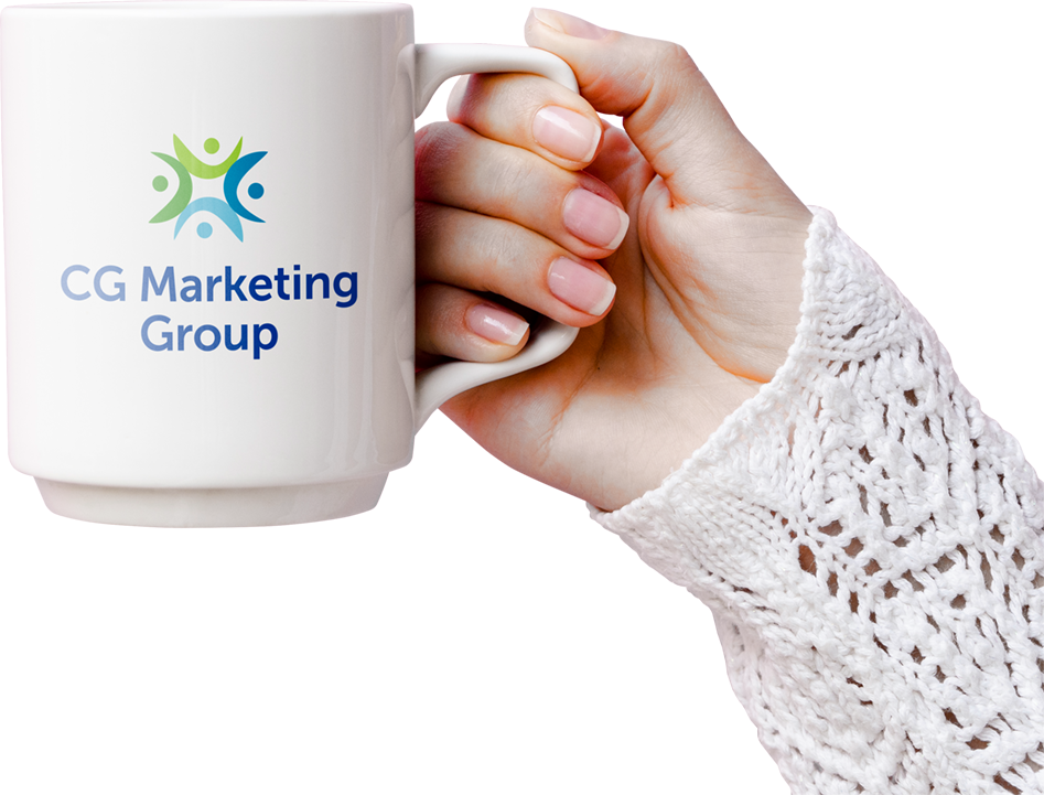 http://Female%20hand%20holding%20a%20coffee%20mug%20with%20Creative%20Graphics%20Marketing%20Group%20logo%20printed%20on%20the%20side