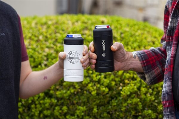 Two guys holding beverages in slim can coolers.